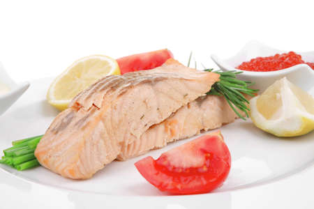 sea food : roasted wild salmon fillet with chives, lime, red caviar, soybean sauce on white dish isolated over white background photo