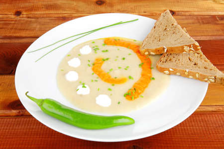homemade cuisine : salmon vegetable soup with bread and chives over wood photo