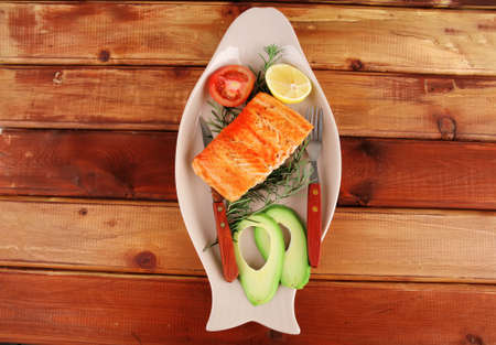 served fish: roast salmon fish over glass plate over wood Stock Photo - 11270599
