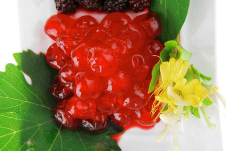 different types of berry on desert plate photo