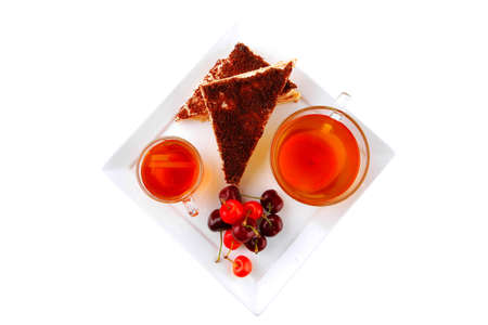 english cake and tea with cherry on white plate photo