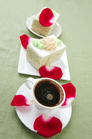 sweet breakfast : whipped cream on sweet cake with hot black coffee photo