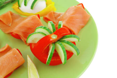 salmon on green dish with boiled eggs photo