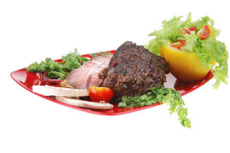 grilled beef sliced on red plate over white photo