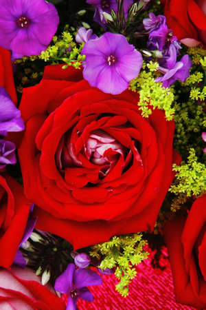 flowers : big bouquet of rose and pansy flowers with green grass in red wrapping papper Stock Photo - 11473022