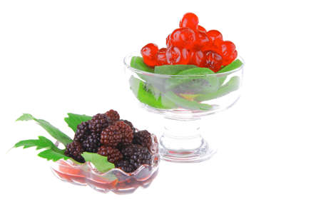 black and red berrys in transparent glass bowl photo