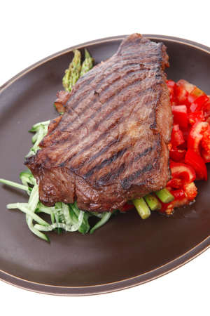 meat table : rare medium roast beef fillet with tomatoes and asparagus served on dish isolated over white Stock Photo - 11472885