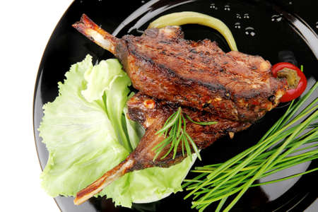 meat savory: roast ribs on black plate with peppers and chives Stock Photo - 11529875