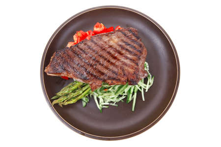 meat table : grilled beef fillet with asparagus and tomatoes served on dish isolated over white Stock Photo - 11530614