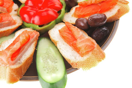 fresh vegetables with salmon on dark dish Stock Photo - 11530384
