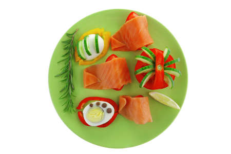 salmon slice and cooked egg and vegetables photo