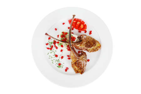 baby rice: main course: grilled ribs with rice and tomatoes on white plate over white background Stock Photo