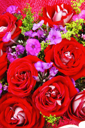 flowers : big bouquet of rose and pansy flowers with green grass in red wrapping papper Stock Photo - 11635776
