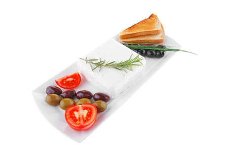 mediterranian: image of soft feta cube and bread toast on plate