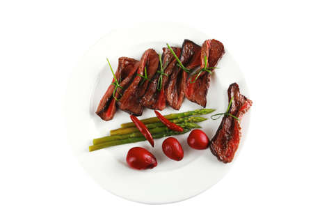 side dish: curved meat slices on white dish with vegetables