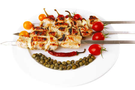 fresh roast pork shish kebab on white platter photo