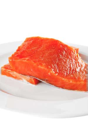 smoked salmon chunk on a big white plate photo