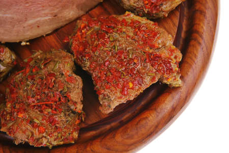 served peppered roast meat chops on wood photo