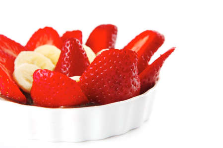strawberry fruit salad isolated on white plate photo