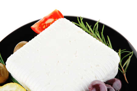 mediterranian: image of feta cube on black plate Stock Photo