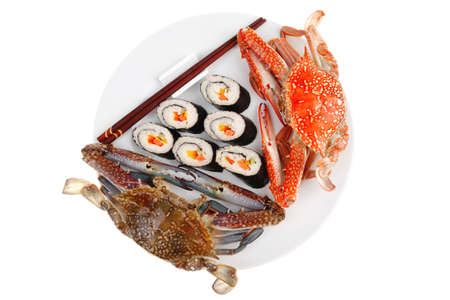 Japanese Traditional Cuisine - California Roll with Avocado and Salmon, Cream Cheese . on black dish with red and blue crabs .  photo