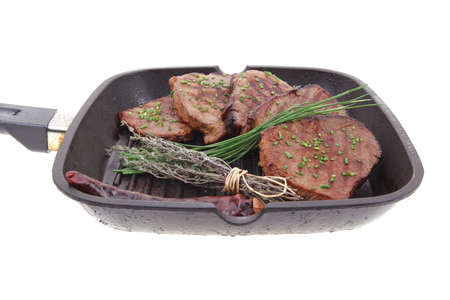fresh bbq red meat with thyme and cayenne pepper on barbecue pan isolated on white background Stock Photo - 11903824