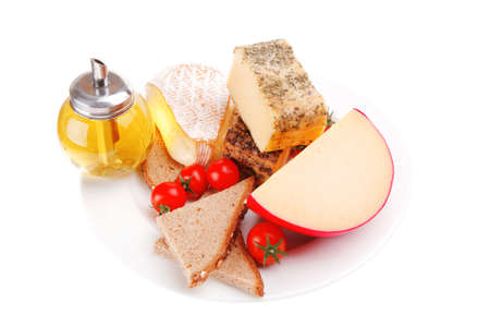 cheeses served with olive oil and bread photo