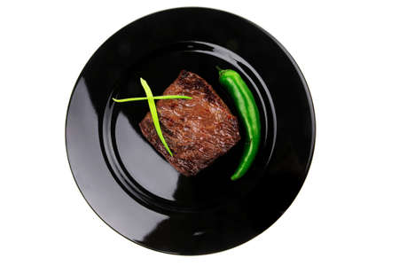 meat savory : grilled beef fillet mignon on black plate with pepper and chives isolated over white background Stock Photo - 11967997
