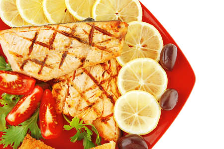 king salmon: grilled pink salmon with lemon and toasts Stock Photo