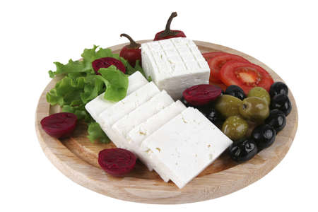 goat cheese served with vegetables on wooden plate photo
