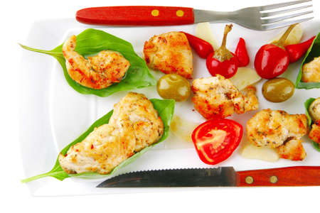 fried chick on long white plate with vegetables photo