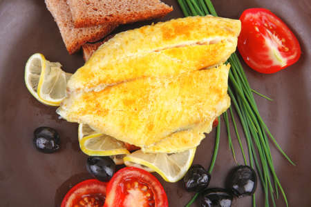 served roast golden fish fillet with tomatoes, rye bread and olives Stock Photo - 12265664