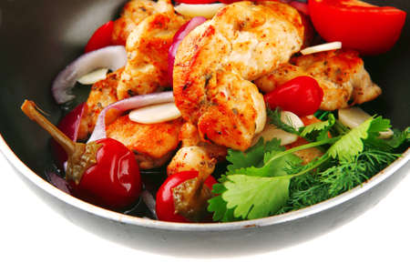 chicken briskaet fried on pan with vegetables photo