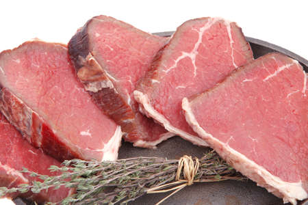 raw beef meat fillet on pan isolated on white background photo