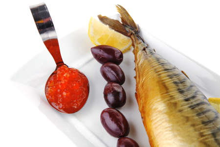smoked fish served on plate with red caviar photo