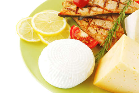 roast salmon and soft cheeses on green over white Stock Photo