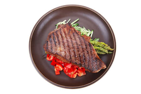 meat table : rare medium roast beef fillet with tomatoes and asparagus served on dish isolated over white Stock Photo - 12528759