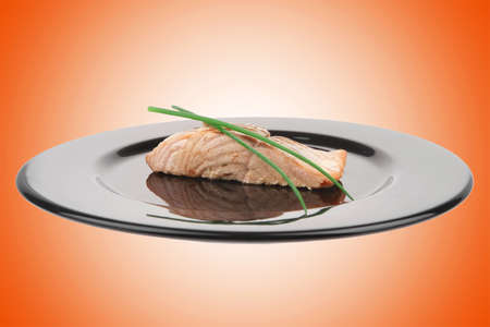 sea food : roasted pink salmon fillet with chinese onion, on black dish isolated over white background Stock Photo - 12527776