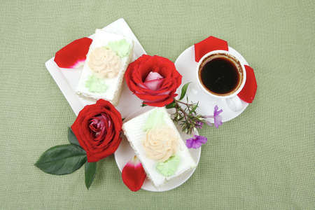 sweet food : milked cream cake with roses and hot black coffee cup Stock Photo - 12531245
