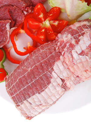 raw meat on white plate with vegetables Stock Photo - 12529367