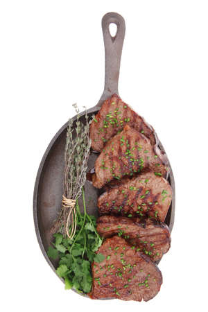 barbecued beef meat on pan isolated on white background Stock Photo - 12530662