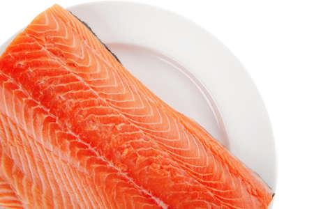 raw big salmon bar on white plate photo