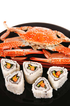 Roll with Cucumber , Cream Cheese with raw Tuna and Salmon inside. on black dish with boiled crab . Japanese traditional Cuisine Stock Photo - 12697233