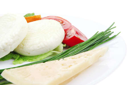 aged cheese : parmesan roquefort and gruyere chops delicatessen cheeses and soft feta on plate isolated over white background photo