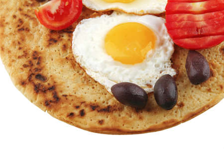 fried eggs on pancake over white background photo