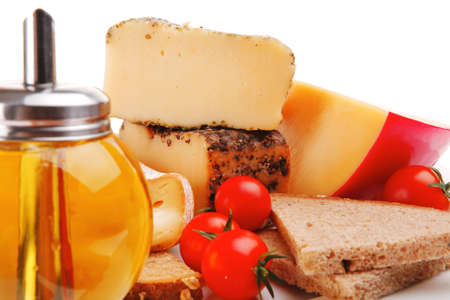 image of cheeses and olive oil on plate photo