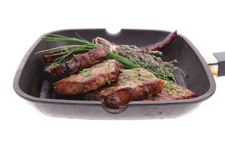 roasted beef meat on bbq pan with pepper and thyme isolated on white background Stock Photo - 12713763