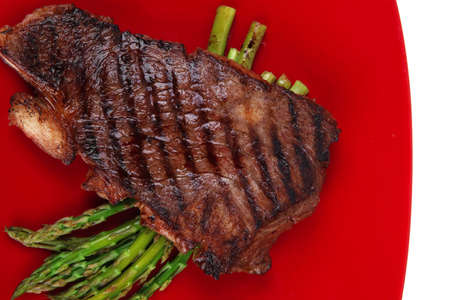 meat table : rare medium roast beef fillet asparagus served on red dish isolated over white Stock Photo - 12767212