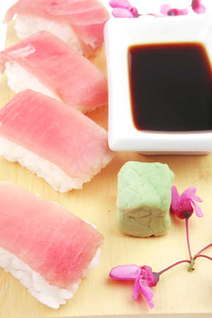 maguro: Japanese traditional Cuisine - Set of Nigiri sushi topped with raw Tuna (maguro) . Isolated over white background