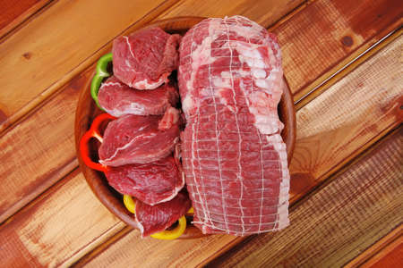 fresh raw meat prepared for cooking on wood photo